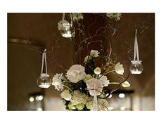 hanging votives and branches for smaller tables-  Something similar with more flowers for Kendall and John's table