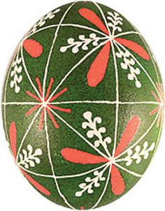 Blown Pysanka with a Tripod. The Tripod symbolizes a trinity such as man-woman-child and even the Holy Trinity of God the Father, Son and Holy Spirit. Green is the color of hope, while orange reflects endurance and everlasting sun.