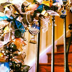 Hanukkah garland made by pinner Cathy Horowitz  with blue, silver, and gold lame + pearly ribbon on a rope with gold, silver and pearl beads on wire + glass Hanukkah ornaments.