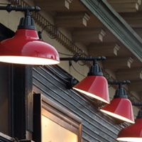 The Danner. Industrial fixture with red shades makes a statement in multiples. Great for commercial applications.