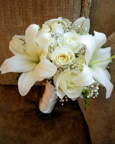 White Casablanca Lilies, White Roses, White Freesia, White Gypsophila Wedding Bouquet