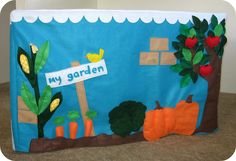 love this felt playhouse garden: can pick veggies from garden and apples from the tree