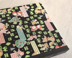 "IONA BINDING - Handmade album that measures 10,23"" x 11,81"". Covered with Japanese fabric."