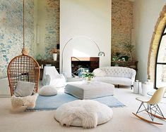 Stone walls! Aqua and pale green accents! Huge arched windows! A rattan swing! Could I love this room any more??