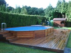 garden pool Swimming Pool Ideas Beautiful - Increasing Your Swimming Pool Area. Be inspired by our selection of swimming pool designs and ideas. Learn more about the different types of pools available and create the perfect pool today. Above Ground Pool Landscaping, Above Ground Pool Decks, Backyard Pool Landscaping, Backyard Pool Designs, In Ground Pools, Above Ground Swimming Pools, Rectangle Above Ground Pool, Residential Landscaping, Landscaping Ideas
