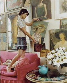 pink sofa and art wall