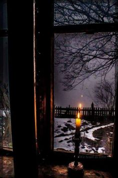 I look out the window where I sheltered from the storm.  A single candle to provide light to see the aftermath of the storm.  It seem so gray and dreary, I decide to spend the rest of the night in my rustic shelter.