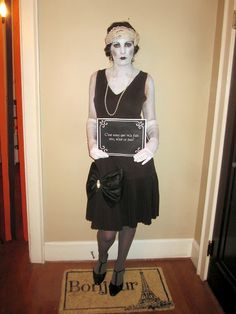 Silent film stars costume. This is great, I've done the old Hollywood/flapper costume, but this is just a little more fun with the signs and the actual black and white make-up.