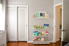 Nursery - Love the shelving for books instead of a bookcase. I like how some book shelves are low so when the baby is old enough they can reach themselves!