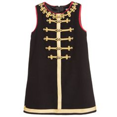 Girls gorgeous military style dress by Dolce & Gabbana. A sleeveless A-line dress made in a soft brushed wool with a silky lining. It has gold military braiding with decorative buttons on the front and is trimmed in red. The back has further braiding, with a concealed zip covered with more decorative buttons.
