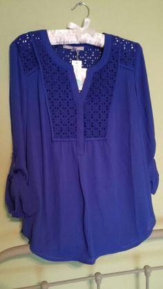 Gorgeous top in beautiful color! Is it flowy? I'd love to try it! Daniel Rainn - stitch fix February 2015