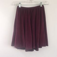 Brandy Melville maroon suede Sammy skirt NWOT Brandy Melville suede sammy skirt. New without tags! Went to brandy and bought this on a whim and then never wore it :( Brandy Melville Skirts Mini