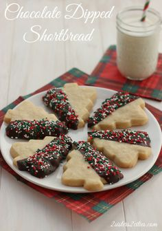 Chocolate-Dipped Shortbread Cutouts- one of my favorite cookie recipes to make for Christmas and year-round (from 2 Sisters 2 Cities) xmas recipes Brownie Cookies, Holiday Cookies, Christmas Shortbread Cookies, Chocolate Dipped Cookies, Spritz Cookies, Chocolate Cupcakes, Chip Cookies, Christmas Cooking, Christmas Desserts