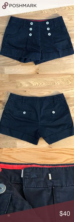 Michael Kors Cropped Shorts Size 6 Michael Kors Cropped Shorts -Size 6 -Top to bottom length: 12 in.  -Dark Navy Blue colorway  -Item was been worn and washed, see photos for details  -$100+ retail -Zip fly -Buttons for decorations -Tap in Michael Kors Shorts