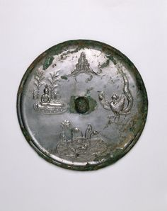 China  Mirror with Images of Purity and Immortality: Mount Penglai, Boya Playing the Qin (Zither), Lotus Pond, and Dancing Phoenix, Tang dynasty (618–907), 8th century  Bronze #