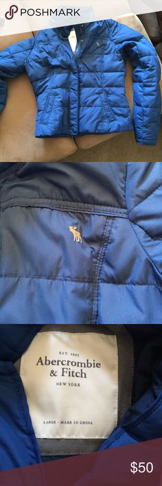 Abercrombie and Fitch puffy jacket Royal blue puffy down jacket ... Warn a handful of times ....is a large/but I would say it is more of a medium/large fit Abercrombie & Fitch Jackets & Coats Puffers