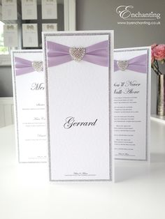 Lilac Wedding | The Aurora Collection - Trifold Table Name and Menu | Featuring silver glitter paper, purple lilac ribbon and diamanté heart embellishment | Luxury handmade wedding invitations and stationery #byenchanting