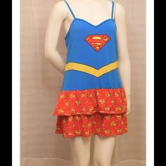 DC comics Superman / Supergirl nightie Thank you for viewing my listing, for sale is a women's / ladies, DC Comics, Superman / superwoman, nightgown / nightie / pajama top. This item is very cute with adjustable straps.  Sz: XL 15-17    Please read the measurements below     From the top of the shoulder strap to the bottom of the item measures approximately 34 inches. And from under one arm to under the other arm measures approximately 17 inches. DC Intimates & Sleepwear Pajamas