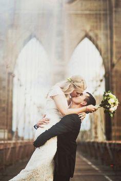 Brooklyn Bridge post-wedding photography: http://www.stylemepretty.com/new-york-weddings/new-york-city/2015/02/17/romantic-new-york-city-elopement/ | Photography: Julie Pepin - http://www.juliepepin.com/