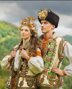 Eastern Europe | Portrait of an Kosmach bride and groom wearing traditional clothes, Carpatian mountings