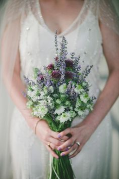 purple and white mountain rustic wedding with photos by Caroline Ghetes | via junebugweddings.com