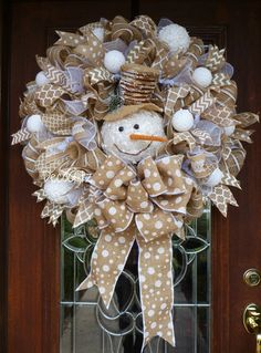 This 28 SNOWMAN Christmas wreath is very full and features burlap and white. It is accented with a cute and rustic snowman, beautiful white polka dot burlap bow and touches of burlap and white ribbon and ornaments!  **IF YOU LIVE OUTSIDE THE CONTINENTAL US, PLEASE CONTACT ME FOR SHIPPING INFORMATION**