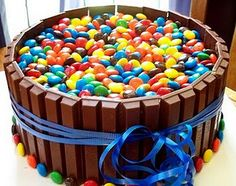 kit kat and m cake. Fill with blue M for pool party.