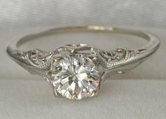 Image result for platinum engagement ring, two small side stones. thin band lots of detailed craftsmanship, low setting