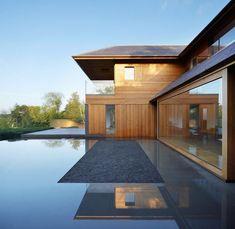 landhaus exterieur glas tür holz material dominiert