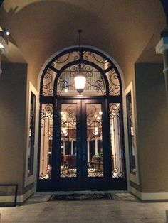 Stunning Wrought Iron Double Door With Transom And Wrap Around Sidelights.