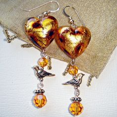 I love dangly earrings. Of the ones in my shop these are my current favourites. Murano and golden birds.
