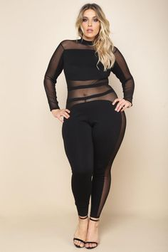 A plus size bodycon jumpsuit with a round neckline. Features long sleeves and long pants. Sheer contrast mesh allover.