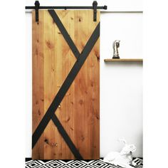 The Mod-Y Barn Door features an asymmetrical Y design overlaid on a solid wood base. This design fits well in modern contemporary, mid-century, or traditional settings.<li>Sliding hardware system **NOT** included with this item</li>