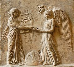 Apollo w. kithara is holding a phiale (flat cup) for Nike (Victory) to pour a libation. Between them is a omphalos (i.e. Marble). Roman copy of the late 1st century CE. Pagan i.e. Pre-Christian neo-Attic Hellenistic era by saamiblog, via Flickr