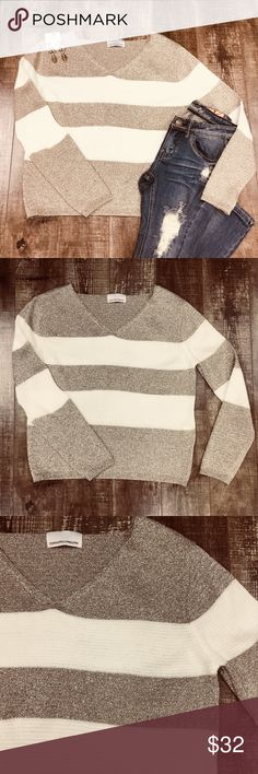 Gold & White Striped V-neck Sweater Glittery and soft. Versatile. No trades. Save 10% by bundling 2 or more regular priced items. 213 Industry Sweaters V-Necks
