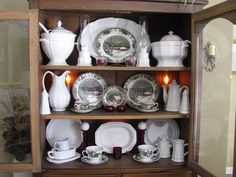 """The china cabinet decorated for winter - a few Johnson Brothers """"Friendly Village"""" china pieces from an auction ($5) with white pieces from my old Pfaltzgraff set."""