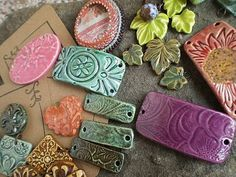 stamped clay - could make lovely hair ties by using stick through and curving over a rolling pin or similar
