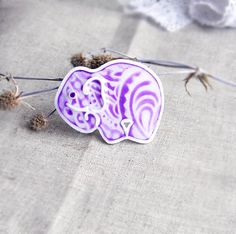 Violet brooch in the shape of an elephant with Indian by OPStyle, $25.00