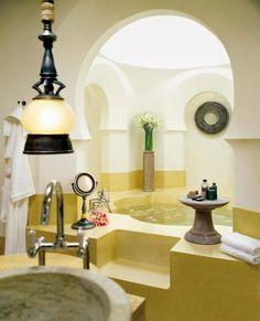 An elegant terrazzo soaking tub for two in Four Seasons Resort Langkawi's double-storey pavilions.