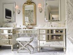 mirrored bureaus and vanity in bathroom from HouseBeautiful