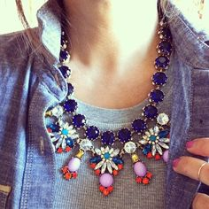 interesting and casual way to wear a statement necklace..