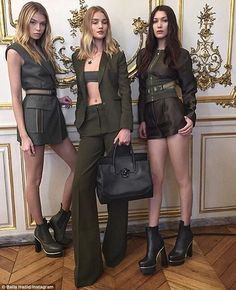Stunners: Bella poses with fellow models Rosie Huntington-Whiteley and Stella Maxwell in a behind the scenes shot from their Versace Palazzo Empire Bag campaign