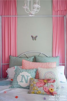 Bright and colorful girl bedroom - simply, low cost, and filled with DIY ideas to decorate on a budget! Tons of crafts and simple decorating ideas. Adding the whimsy and sweet to a little girls bedroom.