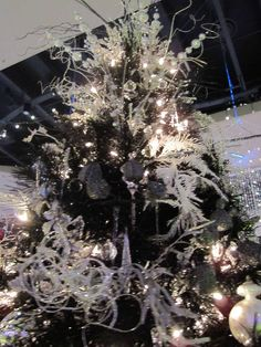Ribbon Christmas Tree Toppers | Edmonton Festival of Trees black Christmas tree Topper Christmas Tree Decorations Ribbon, Tulle Christmas Trees, White Artificial Christmas Tree, Christmas Tree Themes, Christmas Tree Toppers, Christmas Colors, Xmas Trees, Christmas Ideas, Teal Decorations