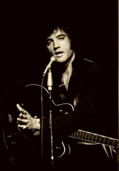 Elvis Presley - i love this photo, I think you can see the older Elvis here, if he had been healthy and lived beyond 42. gorgeous.