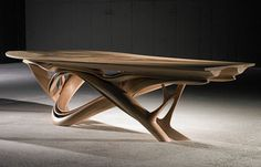 This unique wooden dining table has the power of wood and the irreverence of moden furniture design. It´s the perfect choice to bold dining room decor | http://www.bocadolobo.com