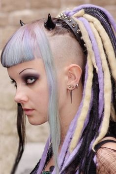 cyber goth, punk girl, shaved side hairstyle, synthetic dreads, piercing, punk hair, goth hair, devil, colored lenses, contact lenses, punk by FuturisticNews.com