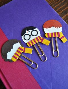 """I solemnly swear that I am up to no good..."" Show off your love for this popular book and movie series everywhere you go with these hand crafted punch art paper clip bookmarks. Made in the likenesses of the three main characters, choose your favorite wizard or witch to adorn the pages of your..."