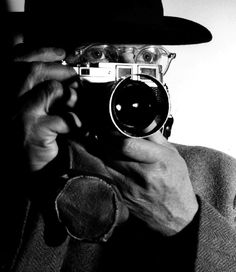 A portrait, taken with a Leica camera, of French photographer Henri Cartier-Bresson - holding a camera up to his face. Henri Cartier Bresson, World Photography Day, Candid Photography, Street Photography, Photography Magazine, Urban Photography, Color Photography, Photography Ideas, Wedding Photography