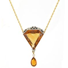 Gold, Platinum, Citrine, Diamond and Black Onyx Pendant with Chain   14 kt., one modified triangular-cut citrine ap. 26.8 x 26 x 11.6 mm., one old European & rose-cut diamonds. Length 16 inches. Art Deco or Art Deco style.